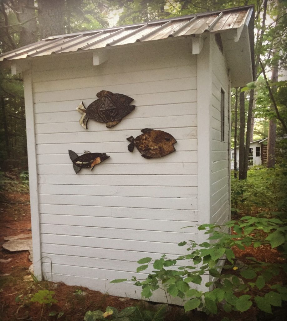 fish on the outhouse